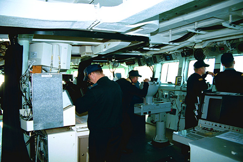 Bridge: The ship is navigated and steered from the bridge. It is always fully staffed when the ship is at sea. From here, the Officer of the Watch gives commands to the helmsman, the lookouts, and the communicators and coordinates various activities around the ship.