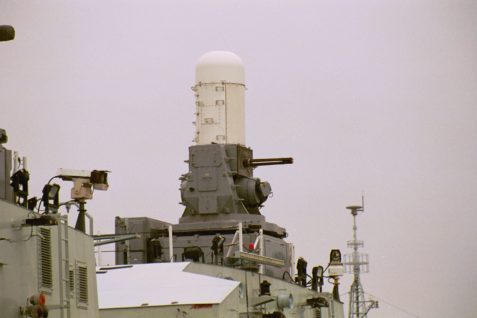 PHALANX 20mm (CIWS) Mk 15 Close-In Weapon System: This weapon's gun assembly consists of a 20 mm M61A1 Vulcan Gatling-principle gun. The M61A1 Vulcan is a six-barreled weapon capable of phenomenally high rates of fire (3000 rds/min). The entire system is capable of dealing with high-angle driving missiles. It also has surface engagement capability. This latter characteristic was developed to meet a perceived requirement for a high-volume-of-fire weapon to engage small high-speed, highly-maneuverable boats, helicopters and low-performance fixed-wing aircraft. The system equips Halifax class frigates (1/ship), Iroquois class destroyers (1/ship) and Protecteur class replenishment ships (2/ship).
