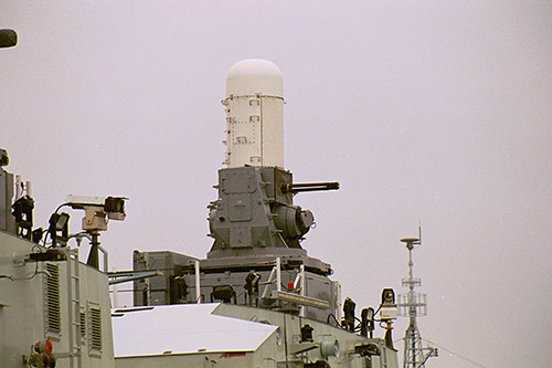 PHALANX 20mm (CIWS) Mk 15 Close-In Weapon System: This weapon's gun assembly consists of a 20 mm M61A1 Vulcan Gatling-principle gun. The M61A1 Vulcan is a six-barreled weapon capable of phenomenally high rates of fire (3000 rds/min). The entire system is capable of dealing with high-angle driving missiles. It also has surface engagement capability. This latter characteristic was developed to meet a perceived requirement for a high-volume-of-fire weapon to engage small high-speed, highly-maneuverable boats, helicopters and low-performance fixed-wing aircraft.
