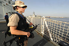 On April 26, 2009 a member of the Naval Boarding Party stands watch as Her Majesty's Canadian Ship (HMCS) Winnipeg participates in an SNMG1 port visit to Karachi Pakistan to increase awareness of NATO activities in the region.  Photo : Warrant Officer Carole Morissette