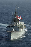 HMCS Toronto flies her Sunday pennant (large Canada Flag) while she sails in the Arabian Gulf.  Photo: MCpl Colin Kelley