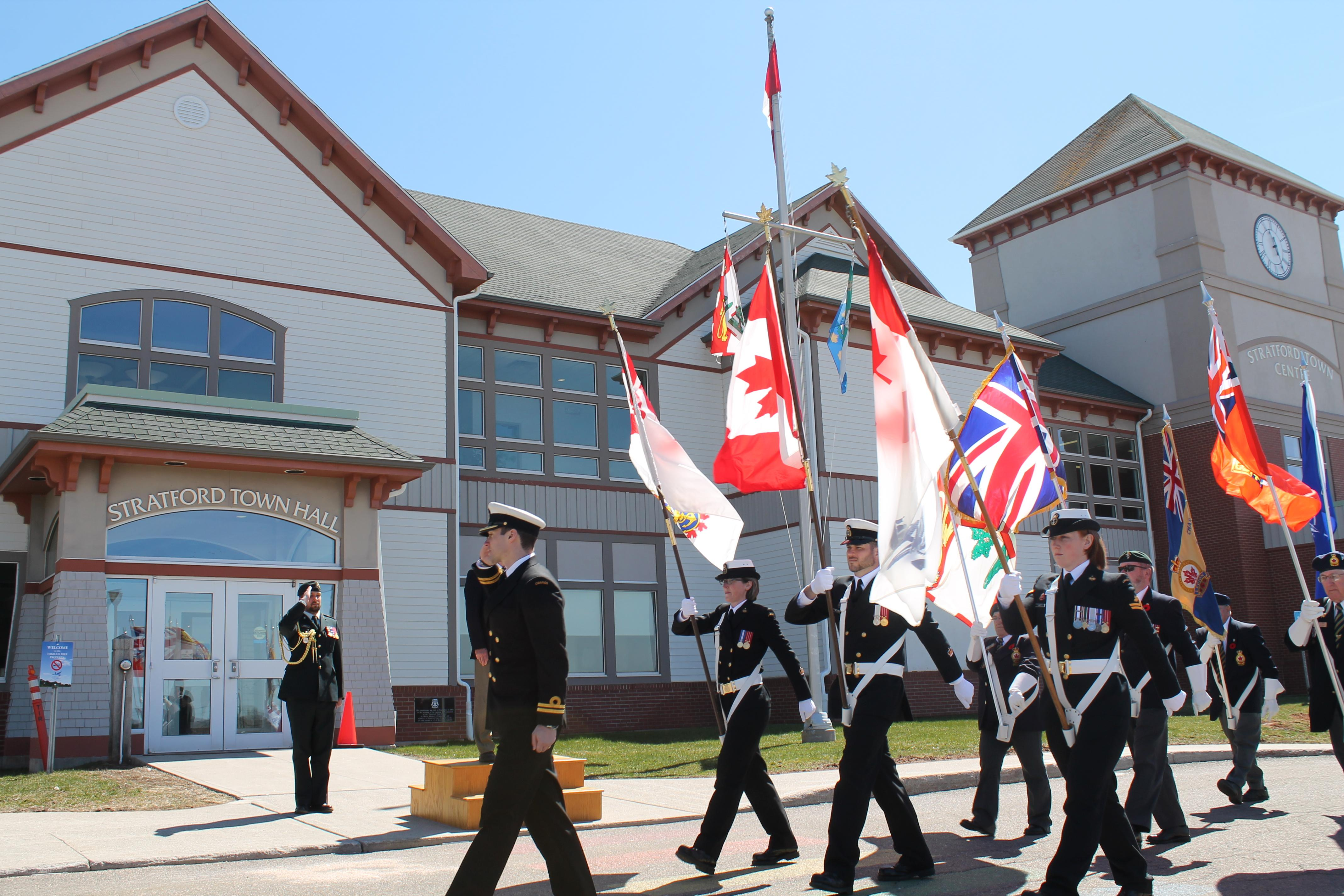 Lt(N) John MacDonald leads the combined HMCS Queen Charlotte and Charlottetown Royal Canadian Legion Colour Party