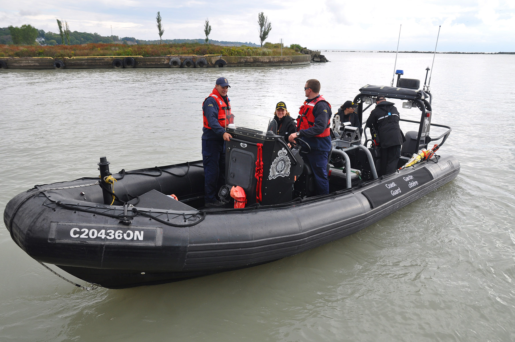 Commodore Mulkins, Commander, Naval Reserve (center) on a joint Canadian Coast Guard / RCMP rigid hulled inflatable boat during Exercise ERIE VALOUR.