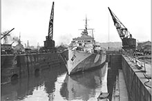 HMCS Prince Robert, one of three Canadian National Steamship liners converted into armed merchant cruisers by the RCN as a stopgap in 1940, is pictured here, in a British drydock in January 1944, after later conversion as an anti-aircraft cruiser.