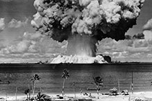 The Bikini Atoll tests were conducted to assess the destructive power of atomic blasts on ships at sea.