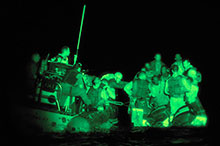 A night vision scope view from the frigate Winnipeg of her boarding party intercepting a boat of Somali pirates, April 2009.