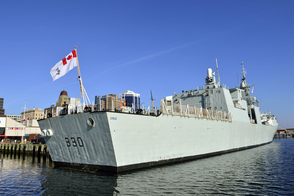 HMCS Halifax flies the Canadian Naval Ensign