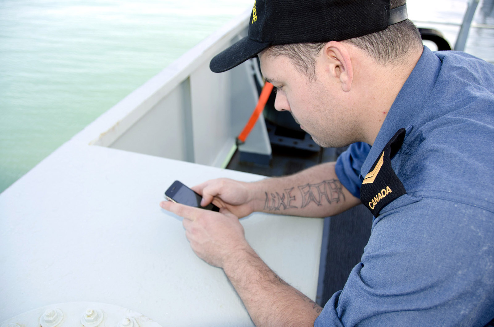 An HMCS Summerside crew member communicates with home.