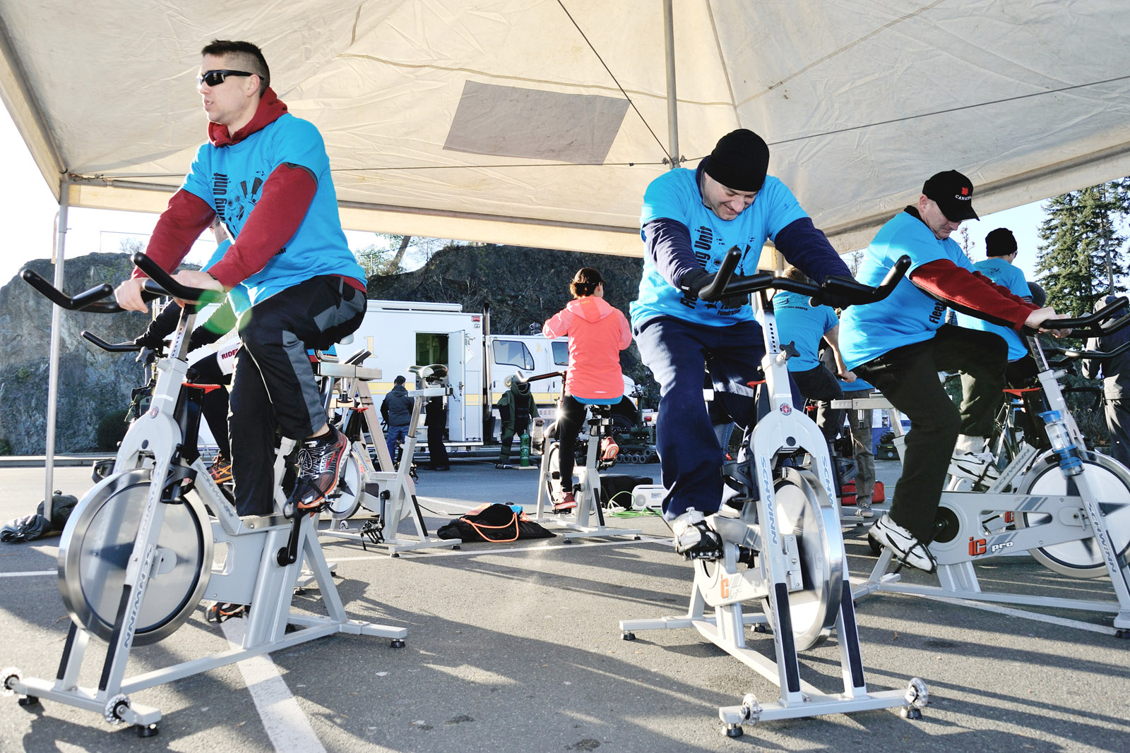 Members of Fleet Diving Unit (Pacific) and friends cycle during the Navy Diver Turkey Fundraiser in support of the Westshore Christmas Hamper Fund Society.