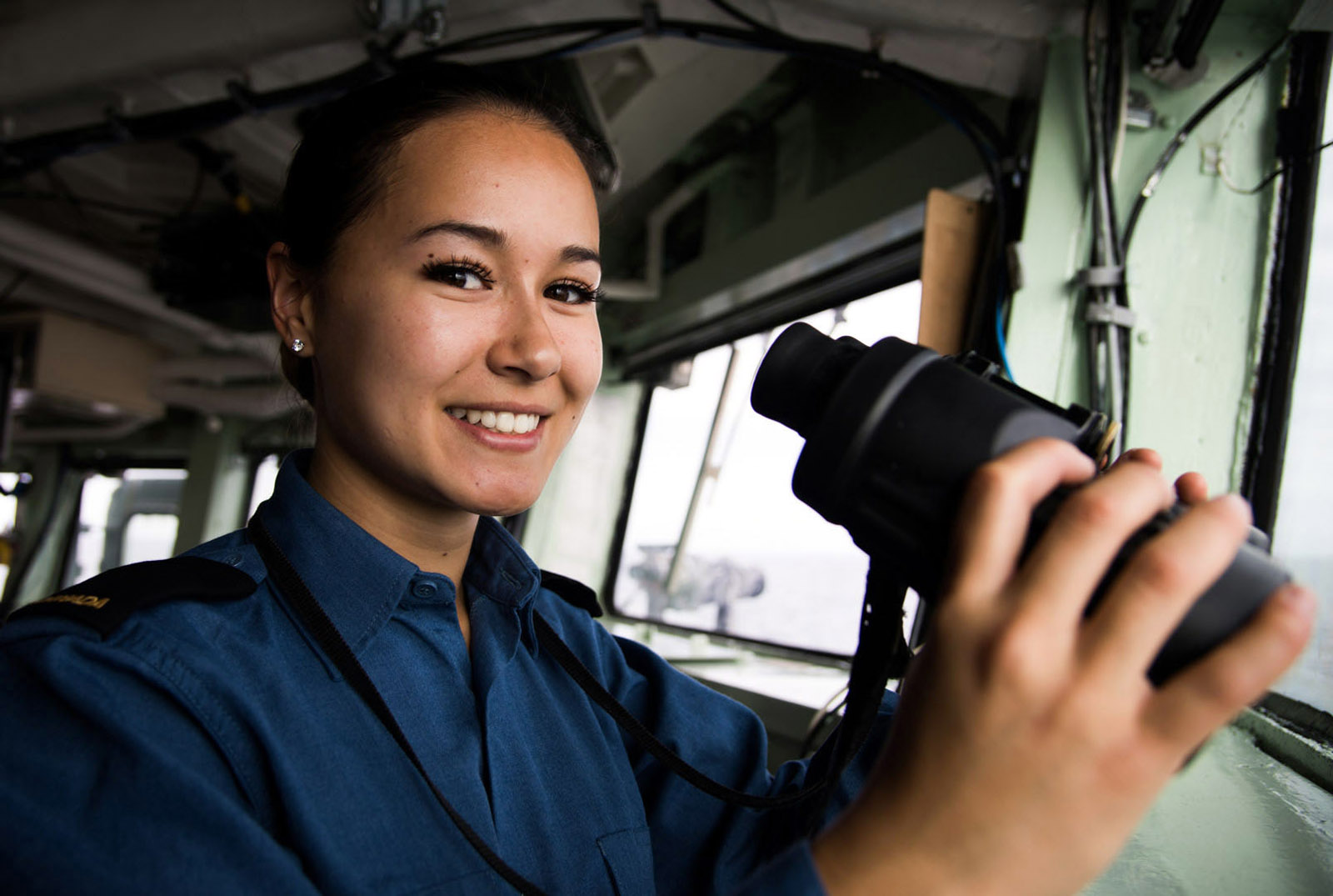 Ordinary Seaman Nathalie Miller of HMCS Montréal watches the horizon for icebergs.