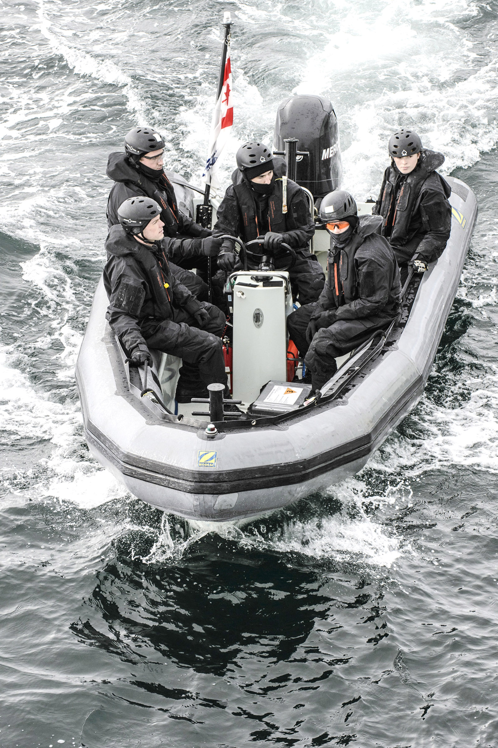 Crew members take out HMCS Edmonton's rigid-hulled inflatable boat on a training exercise in the Beaufort Sea during Op Limpid.