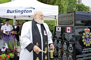 Reverend Bill Thomas blesses the new Korea Memorial Monument during its unveiling in Spencer Smith Park, Burlington, Ont., on July 28. This historic monument is dedicated to the eight Canadian naval destroyers that served in the Korean War from June 1950 until the armistice in July 1953, and patrolled thereafter until September 1955. It also honours the nine crew members who were either killed in action, lost at sea, or died in service, as their names will be inscribed on the monument. The project to erect the Korea Memorial Monument was initiated by members of Korea Veterans Association Unit 26 in Hamilton, Ont., and the HMCS Haida Association. Photo: Cpl Katie Hodges