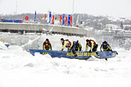 A race to the finish – Sailors from HMCS Ville de Québec race towards the finish line during the Ice Canoe Race at the Carnaval de Québec on February 8. The Canoe Race, a legendary competition, has been held since the Carnaval's first edition. Each year, several courageous teams compete with one another during a tumultuous ride along the St. Lawrence River between Québec City and Lévis. Photo: LS Marilou Villeneuve