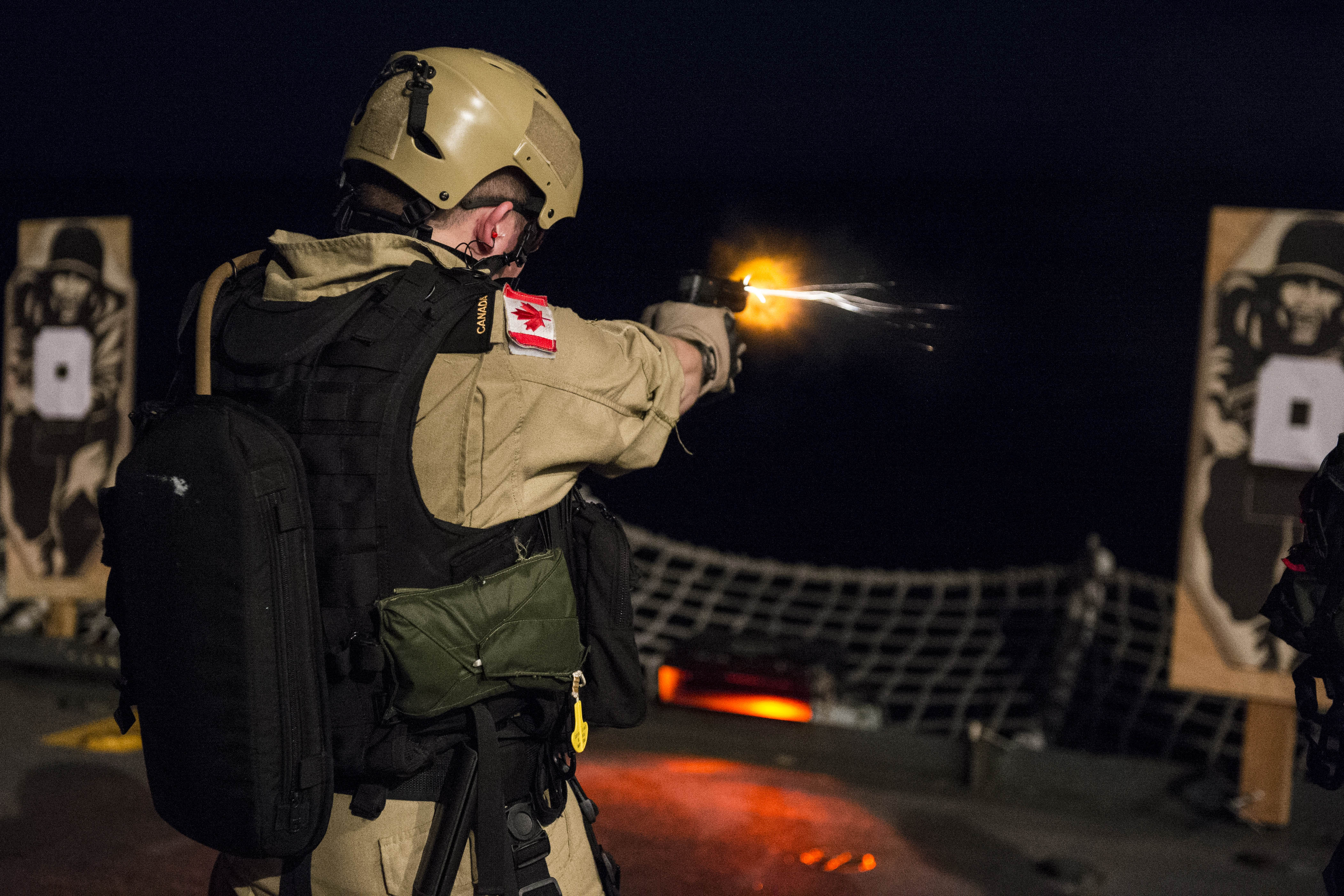 An example of MCpl Bastien's work: The Naval Boarding Party of Her Majesty's Canadian Ship Regina conducts a small arms serial on the flight deck as part of pre-deployment training for OP ARTEMIS on January 18, 2013 in the Pacific Ocean west of Hawaii.