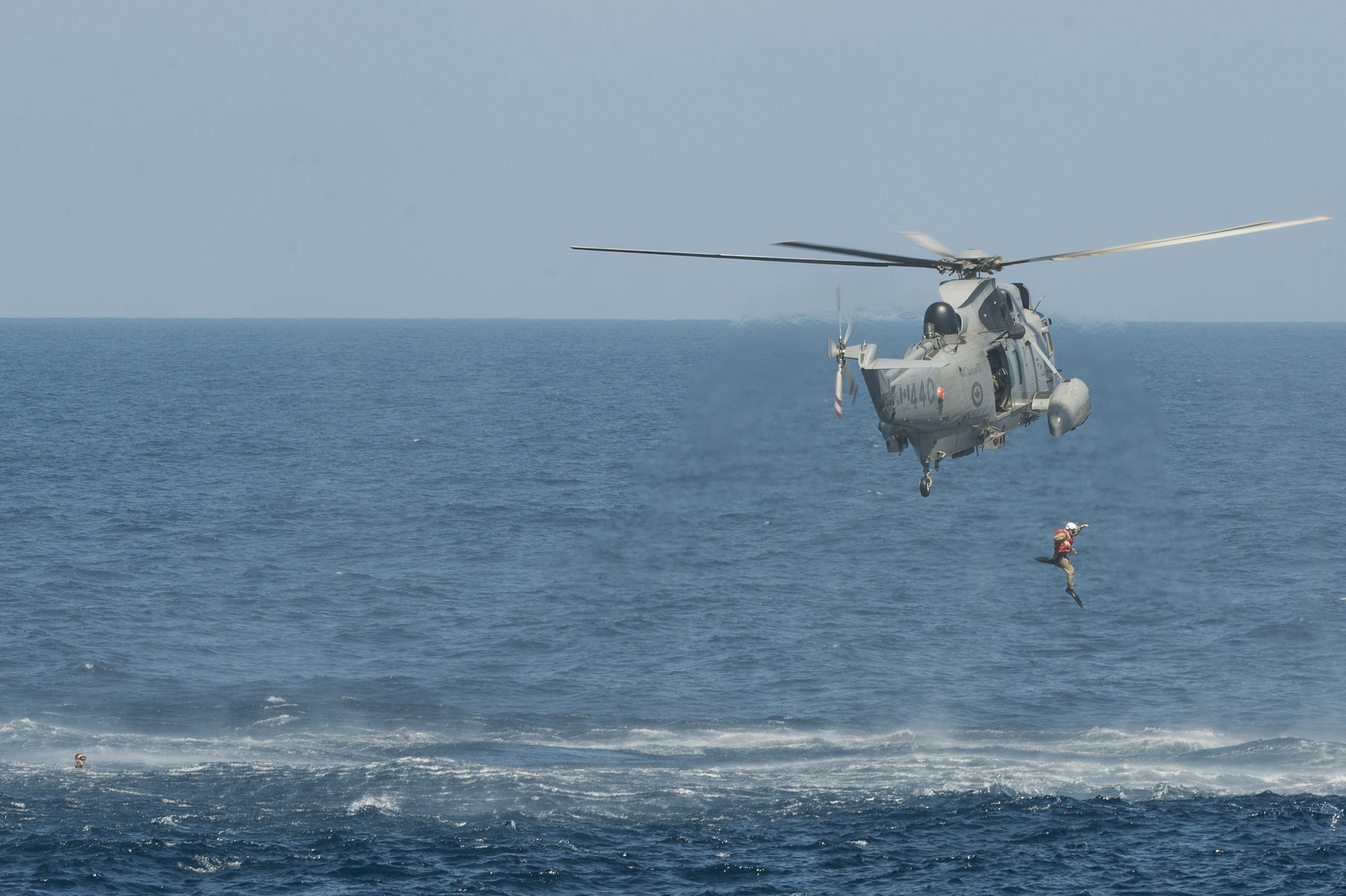 An example of MCpl Bastien's work: The dive team of Her Majesty's Canadian Ship Regina conducts diving operations from the ship's CH-124 Sea King Helicopter in the South China Sea on February 6, 2014.