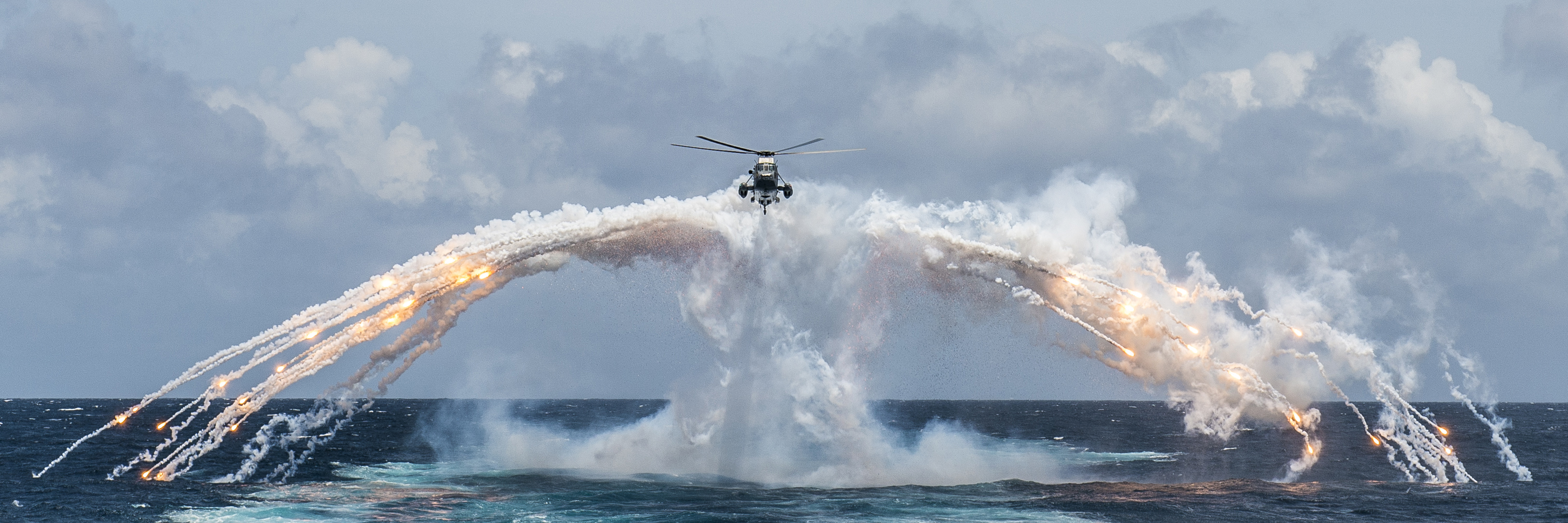 An example of MCpl Bastien's work: Her Majesty's Canadian Ship Regina's CH-124 Sea King helicopter deploys flares during routine flight operation in the Indian Ocean on August 14, 2014.
