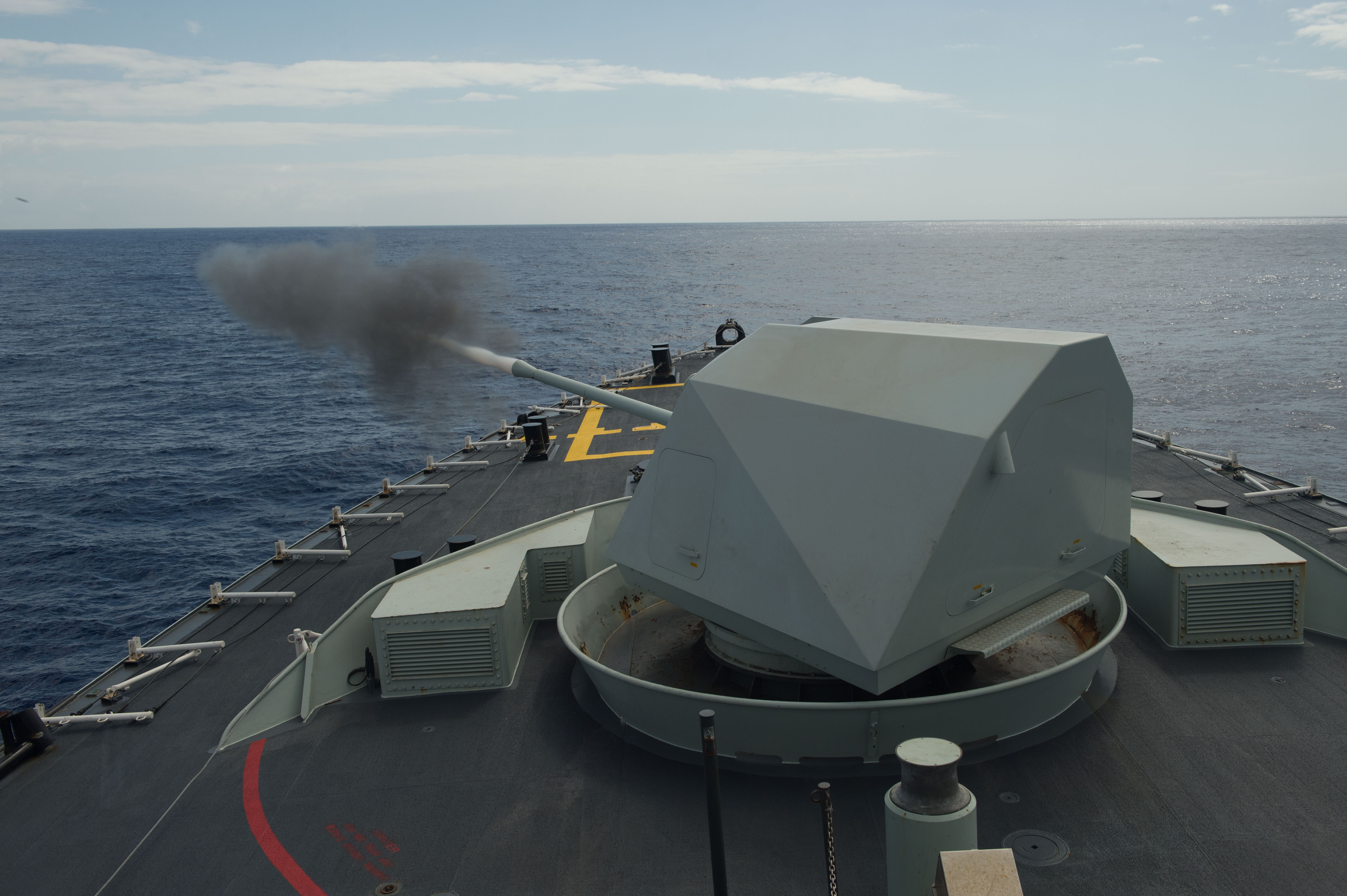 Her Majesty's Canadian Ship WINNIPEG fires the Bofors 57 mm gun