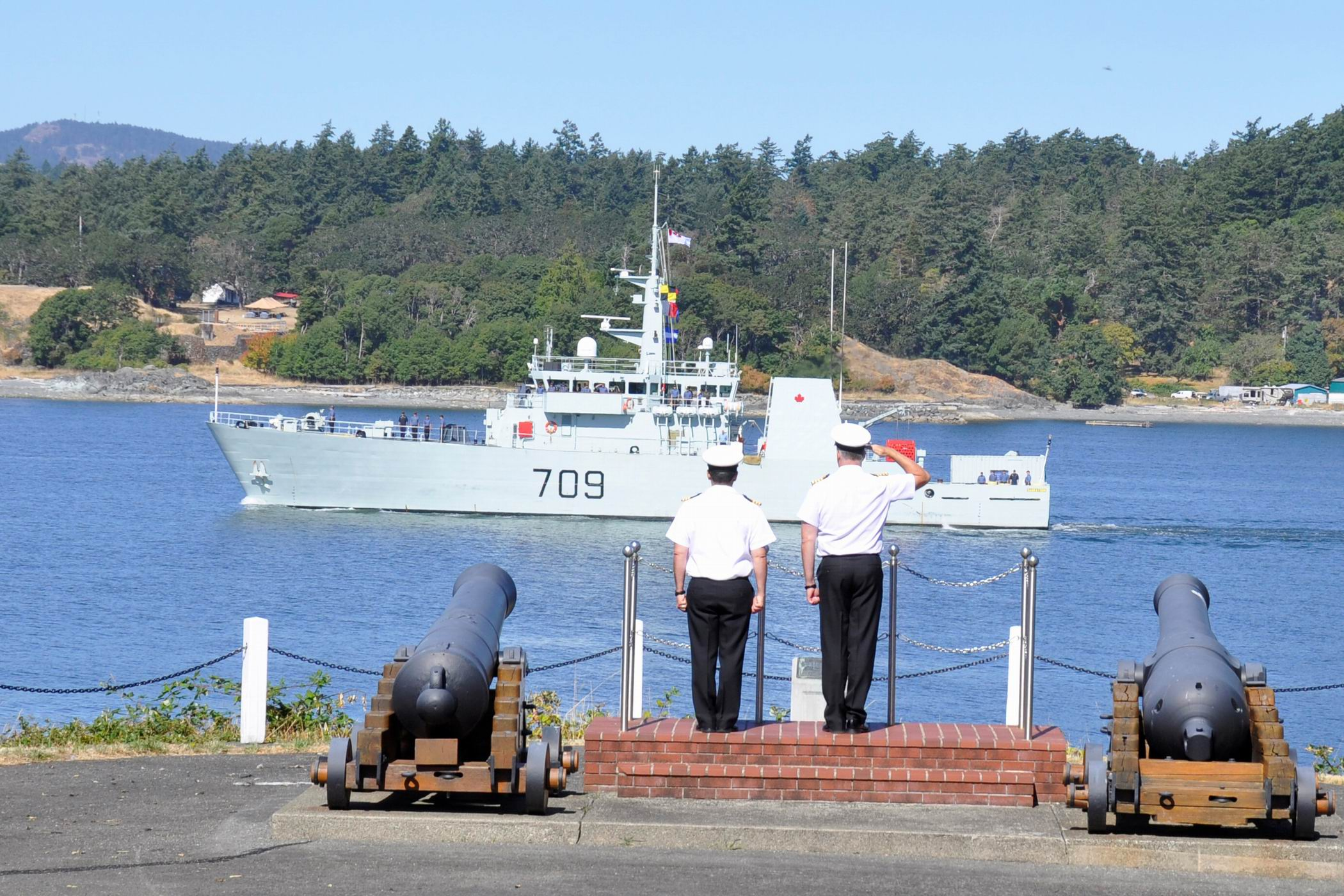 Captain (Navy) Jeff Zwick and Commander Alex Barlow bid farewell to HMCS Saskatoon