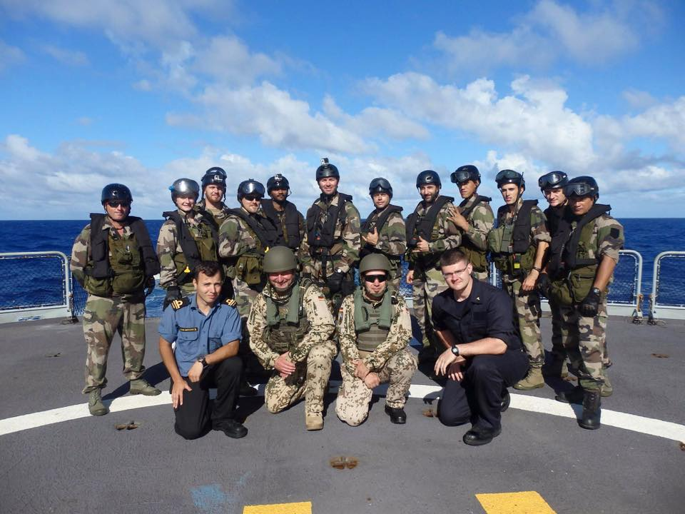 Sub-Lieutenant Jérémie Héon-Miousse (front left) and sailors from France, Germany and the United States unite to conduct a boarding exercise on French Ship Prairial.
