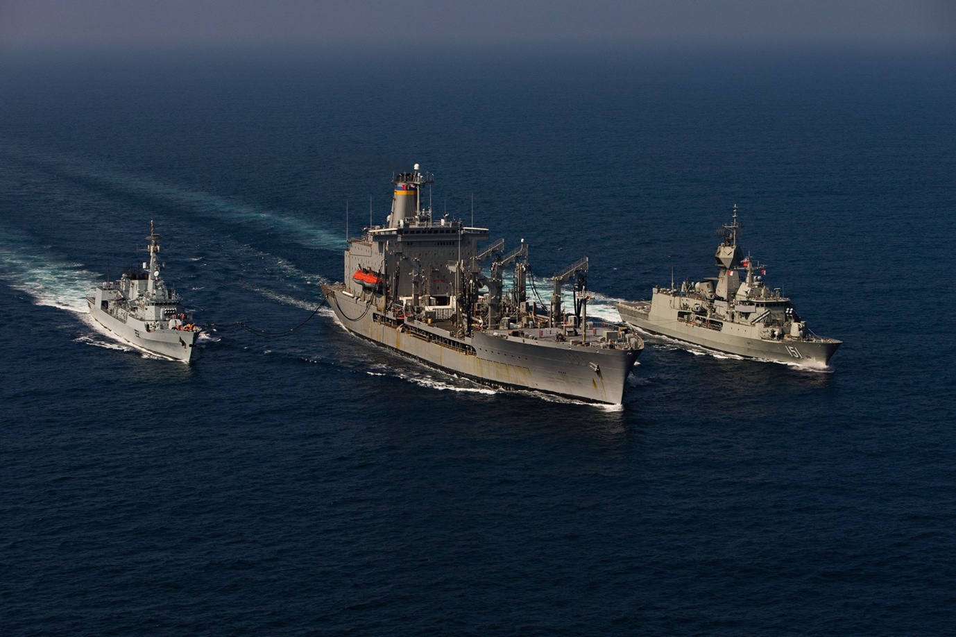slide - Ships conduct replenishment-at-sea operations