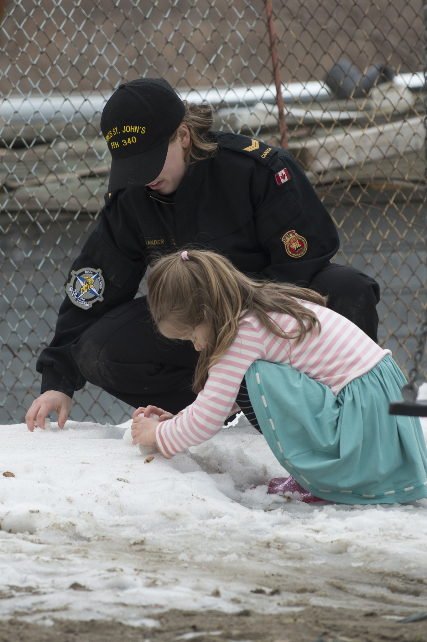 Leading Seaman Michaela Alexander, a Marine Systems Engineer, helps a little girl build a snowman at the Nightingales Children's Project at Cernavoda, Romania, during HMCS St. John's visit to Constanta on February 5, 2017.