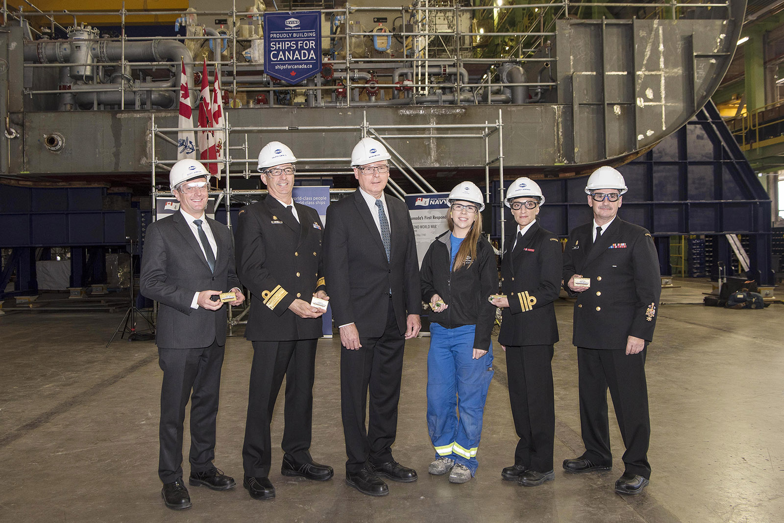 Members of the Royal Canadian Navy and Irving Shipbuilding mark the traditional keel-laying ceremony for the second Arctic and Offshore Patrol Vessel, the future HMCS Margaret Brooke, at Halifax Shipyard on May 29, 2017. From left, Scott Jamieson, Irving Shipbuilding; Rear-Admiral John Newton, Commander of Maritime Forces Atlantic; Kevin McCoy, President of Irving Shipbuilding; Olivia Strowbridge, Production Work Lead, Irving Shipbuilding; Commander Michele Tessier, Commanding Officer (Designate) HMCS Margaret Brooke; and Chief Petty Officer 1st Class Pierre Auger, Maritime Forces Atlantic Formation Chief.