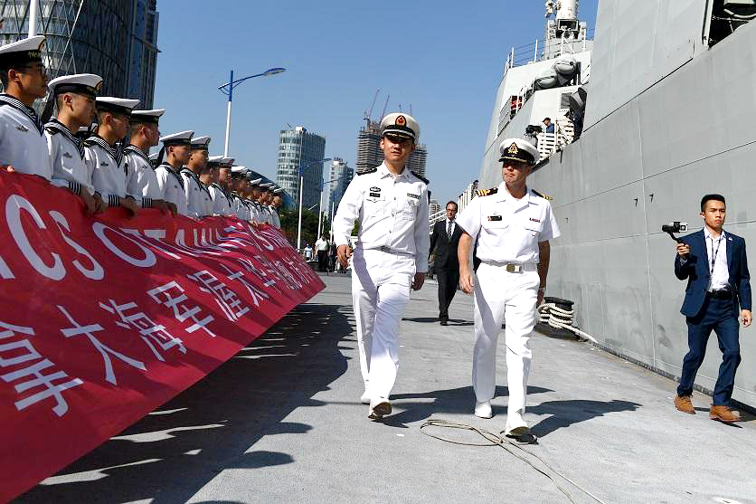 Sailors from HMCS Ottawa gather with Chinese sailors during the ship's visit to Shanghai.
