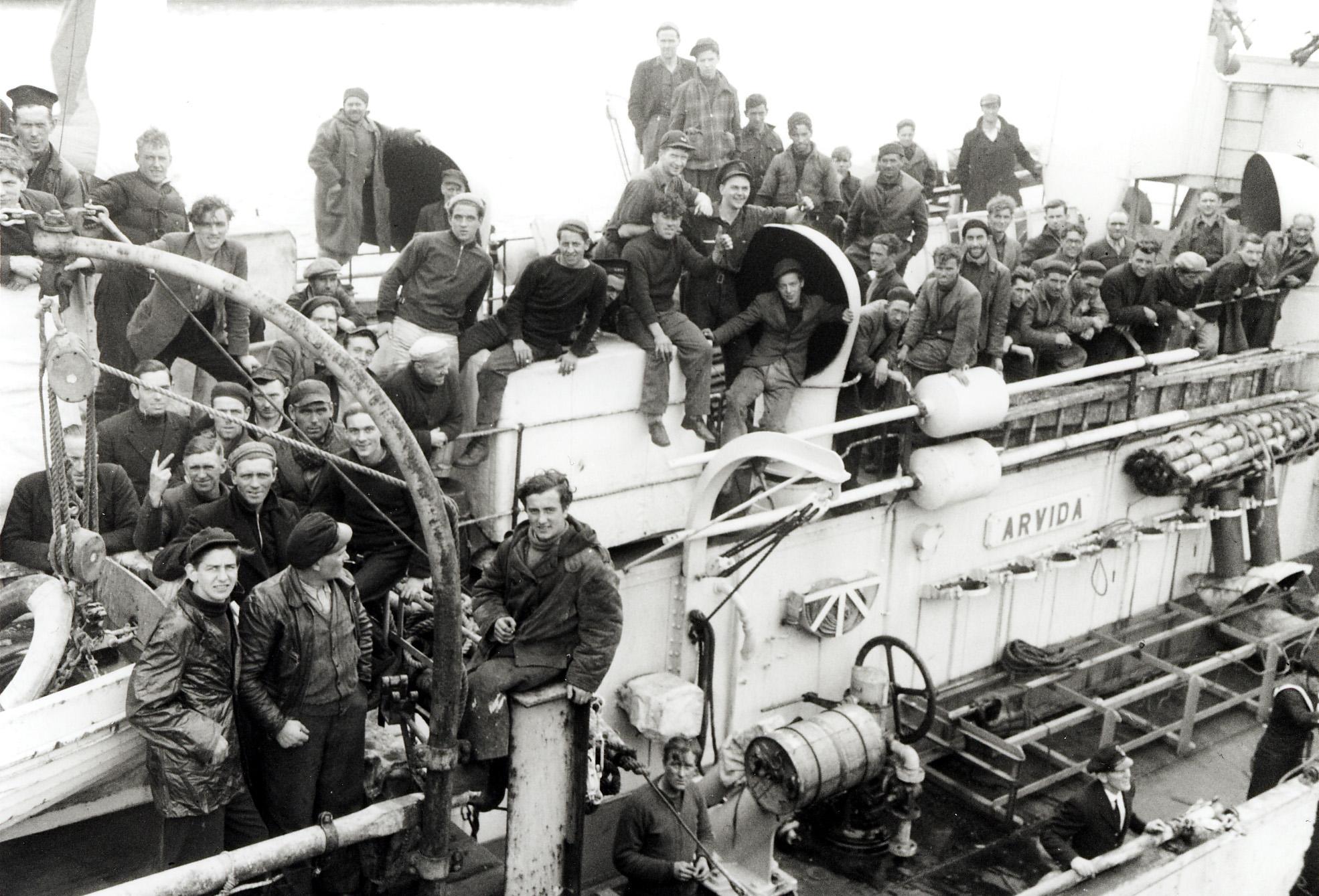 A boatload of seamen from a torpedoed ship aboard HMCS Arvida, St. John's, June 1945. 