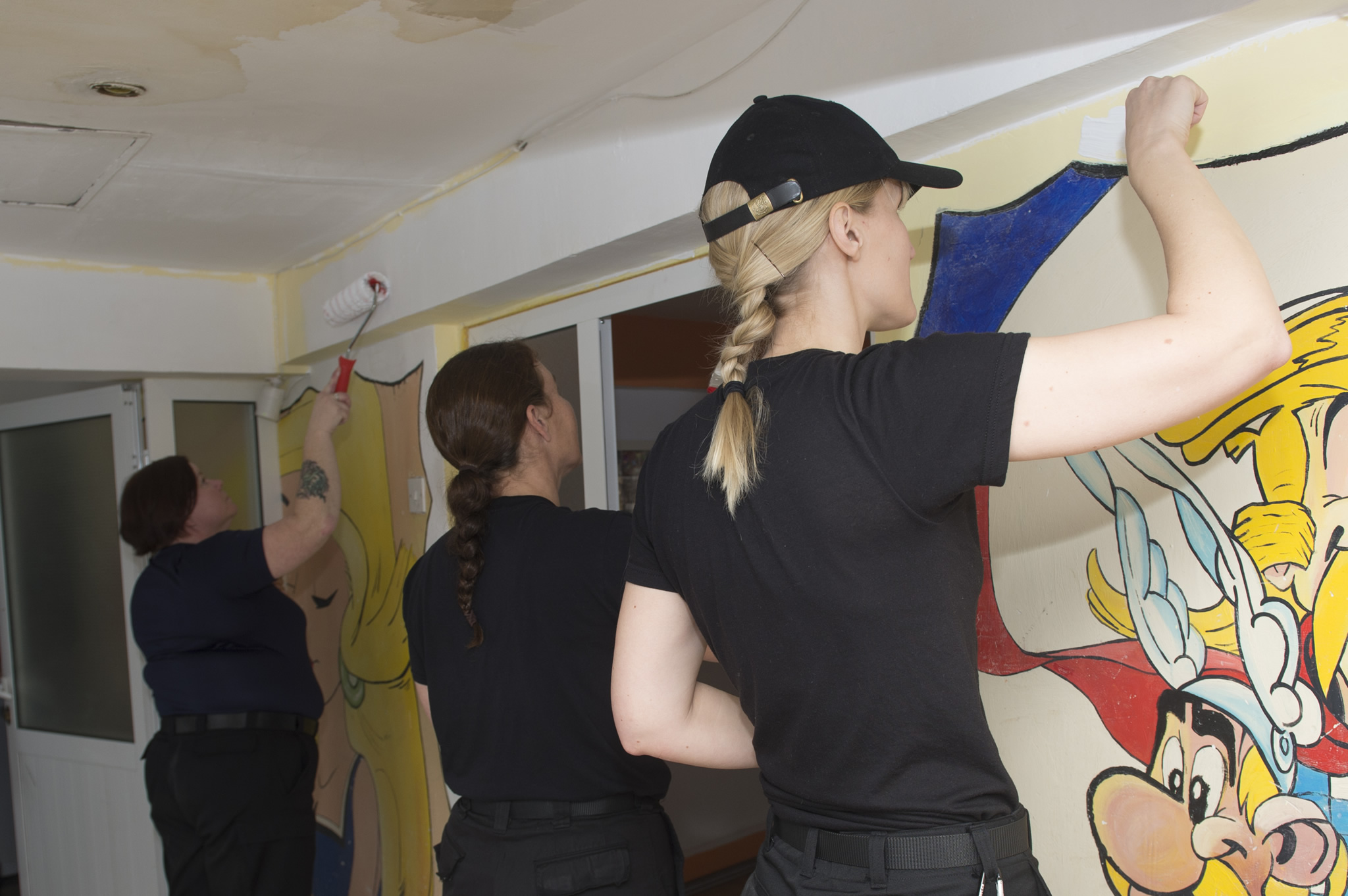 Female members of HMCS St. John's lend a hand in painting at the Nightingales Children's Project in Cernavoda during the ship's visit to Constanta, Romania, on February 5, 2017, during Operation REASSURANCE.