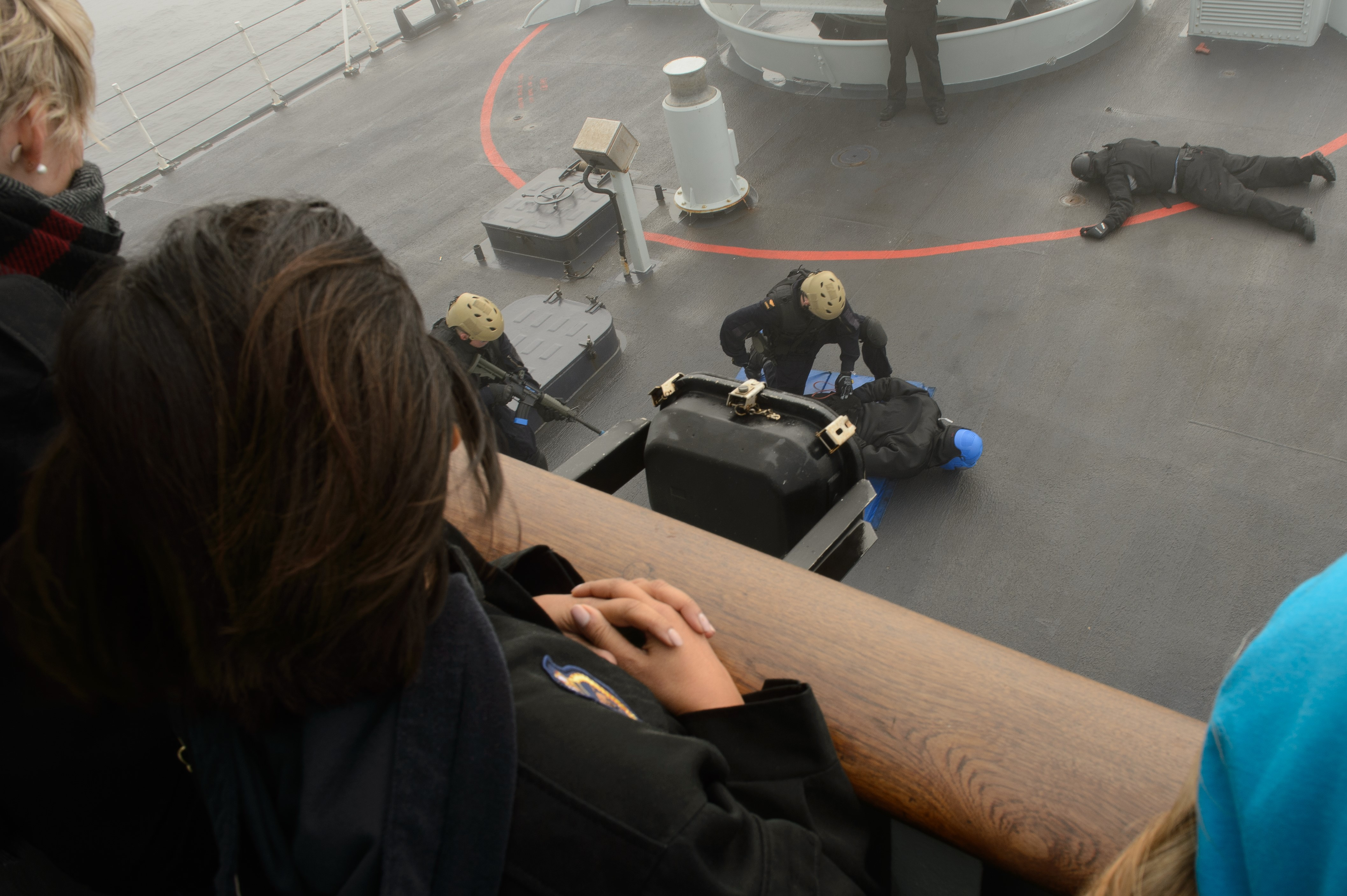 Canadian Leaders at Sea participants watching a Naval Security Team tactical boarding demonstration on HMCS Winnipeg.