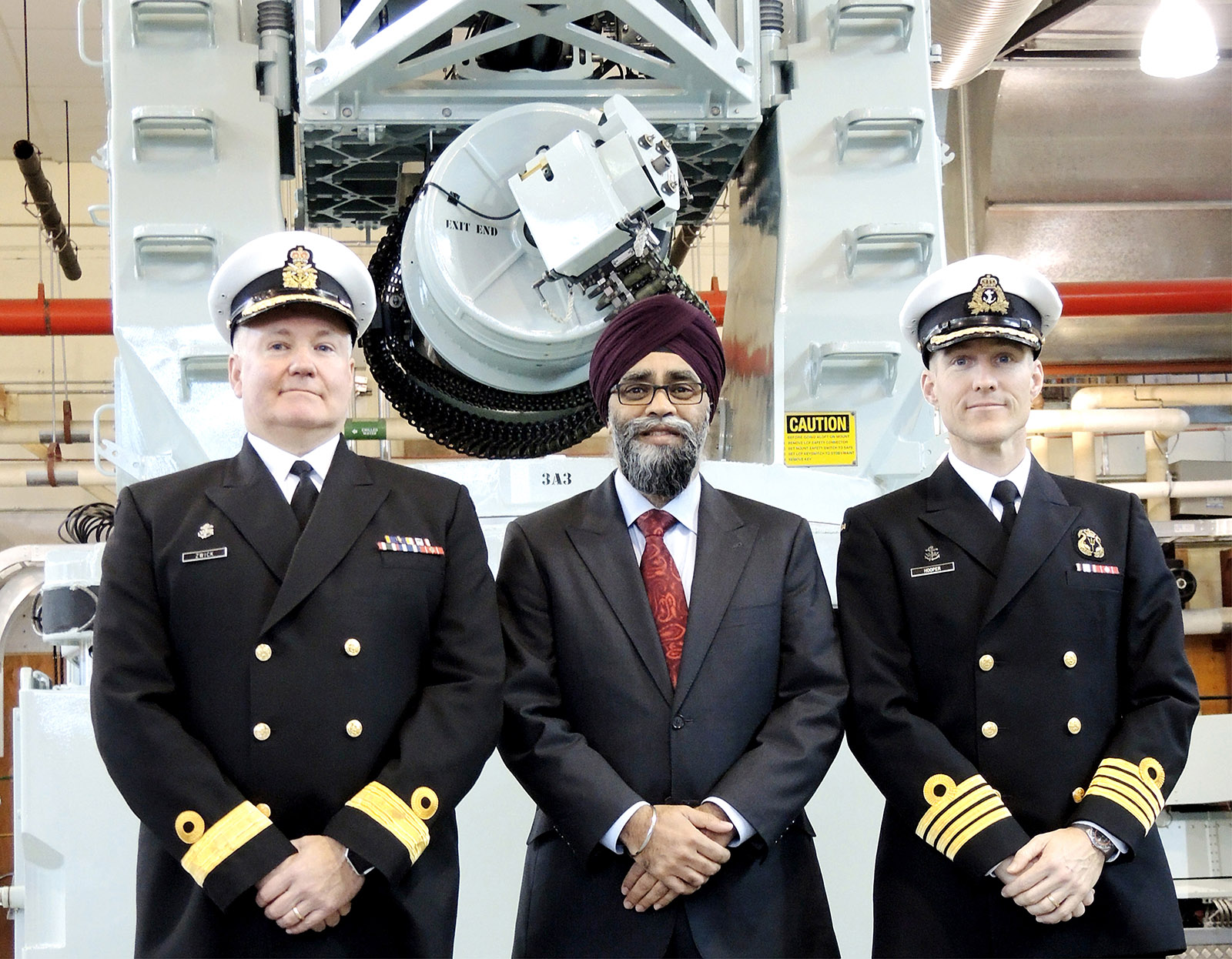Minister of National Defence Harjit Sajjan, Commodore Jeff Zwick and Captain (Navy) Ed Hooper