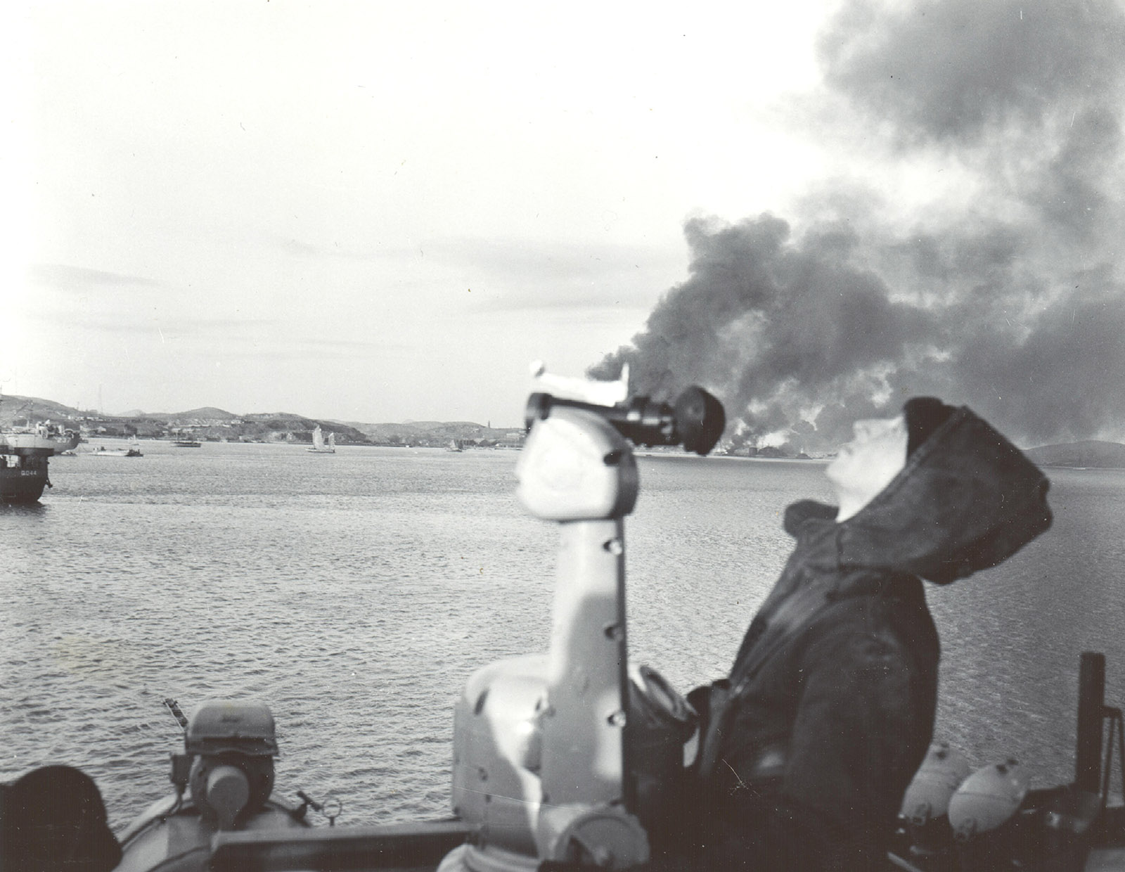 Military installations and supplies go up in flames at Chinnampo, 6 December 1950.