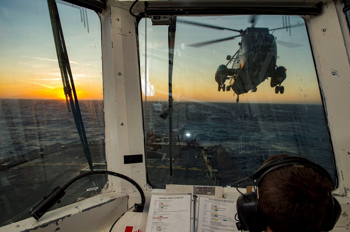 A CH-124 Sea King helicopter prepares to land on HMCS Charlottetown during Operation REASSURANCE.