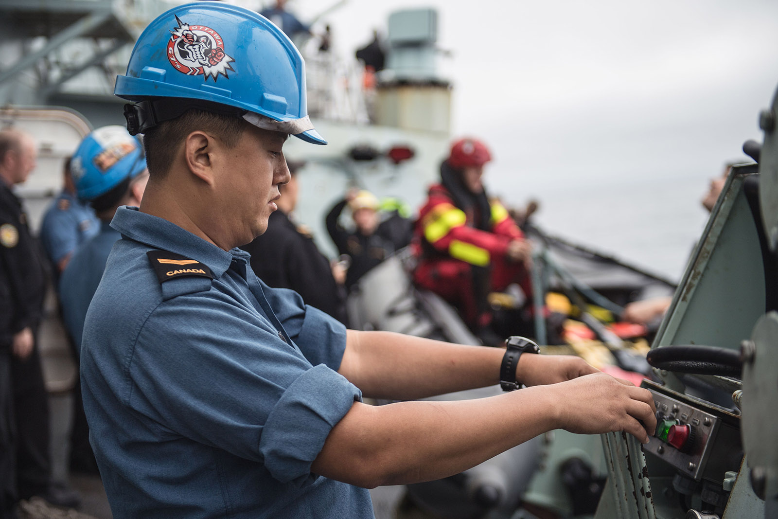 Leading Seaman Gu Yeon Kim operates the crane during a Man Overboard exercise on August 7 2019 onboard HMCS OTTAWA while deployed on OPERATIONS PROJECTION and NEON.