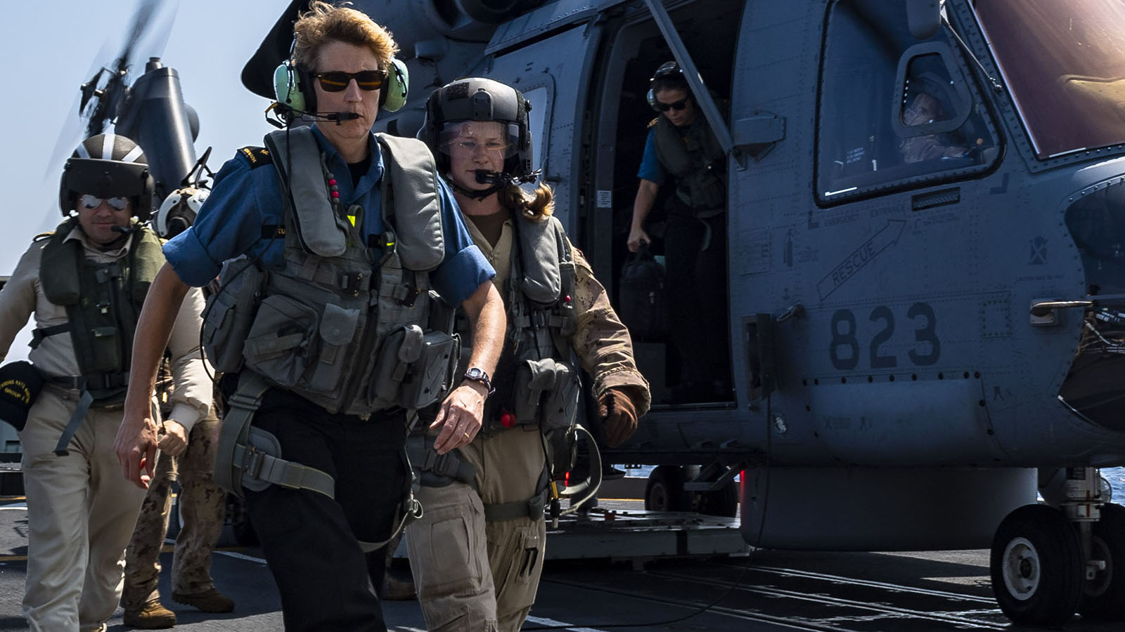 Commodore Josée Kurtz, Commander of Standing NATO Maritime Group Two, exits a CH-148 Cyclone helicopter call sign Kingfisher, after flying over the Mediterranean Sea during Operation REASSURANCE on September 5, 2019. Photo: Corporal Braden Trudeau, Trinity - Formation Imaging Services