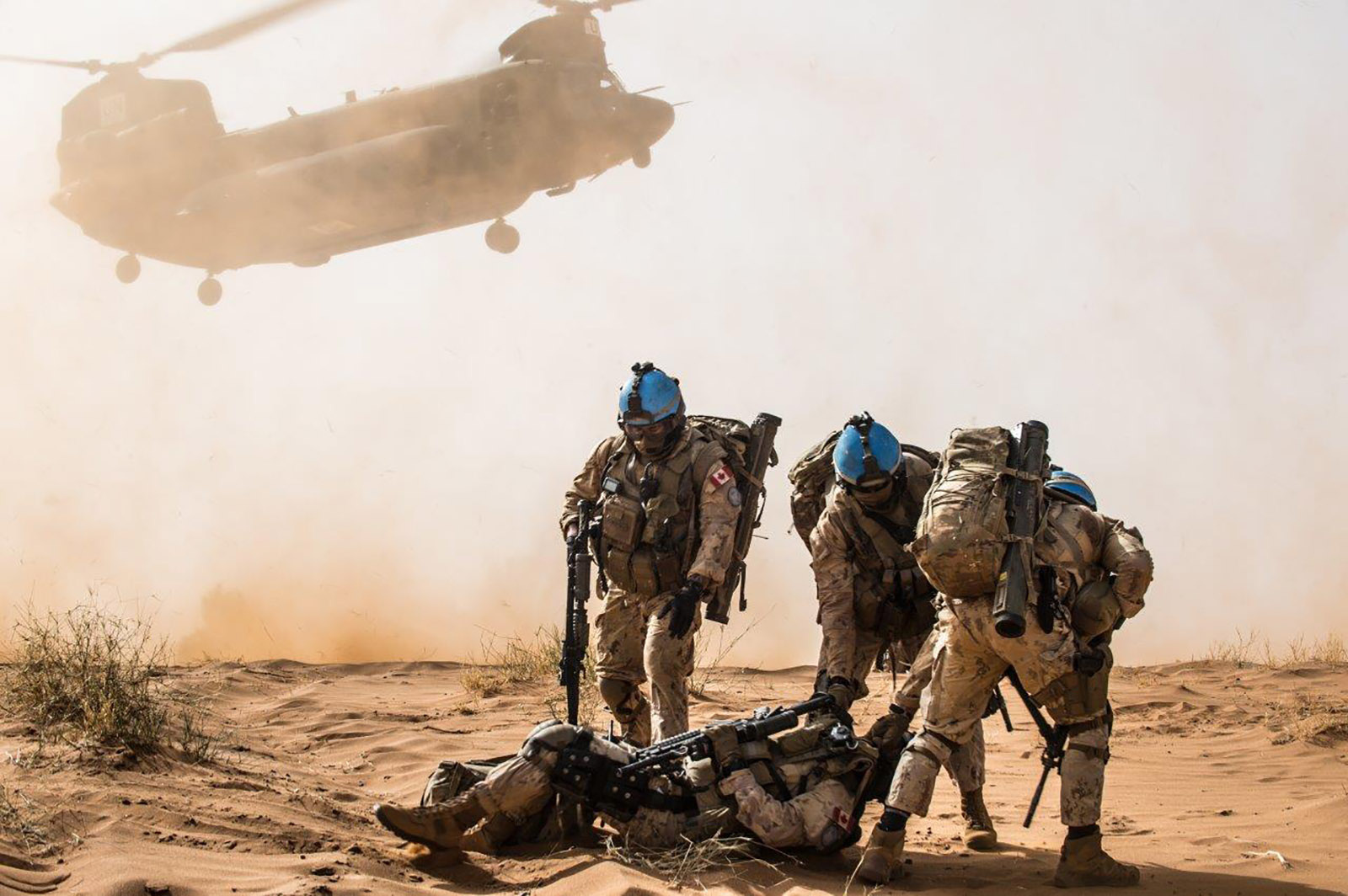Operation PRESENCE-Mali's Force Protection team assists a simulated casualty during a combat casualty exercise in Mali on December 17, 2018.