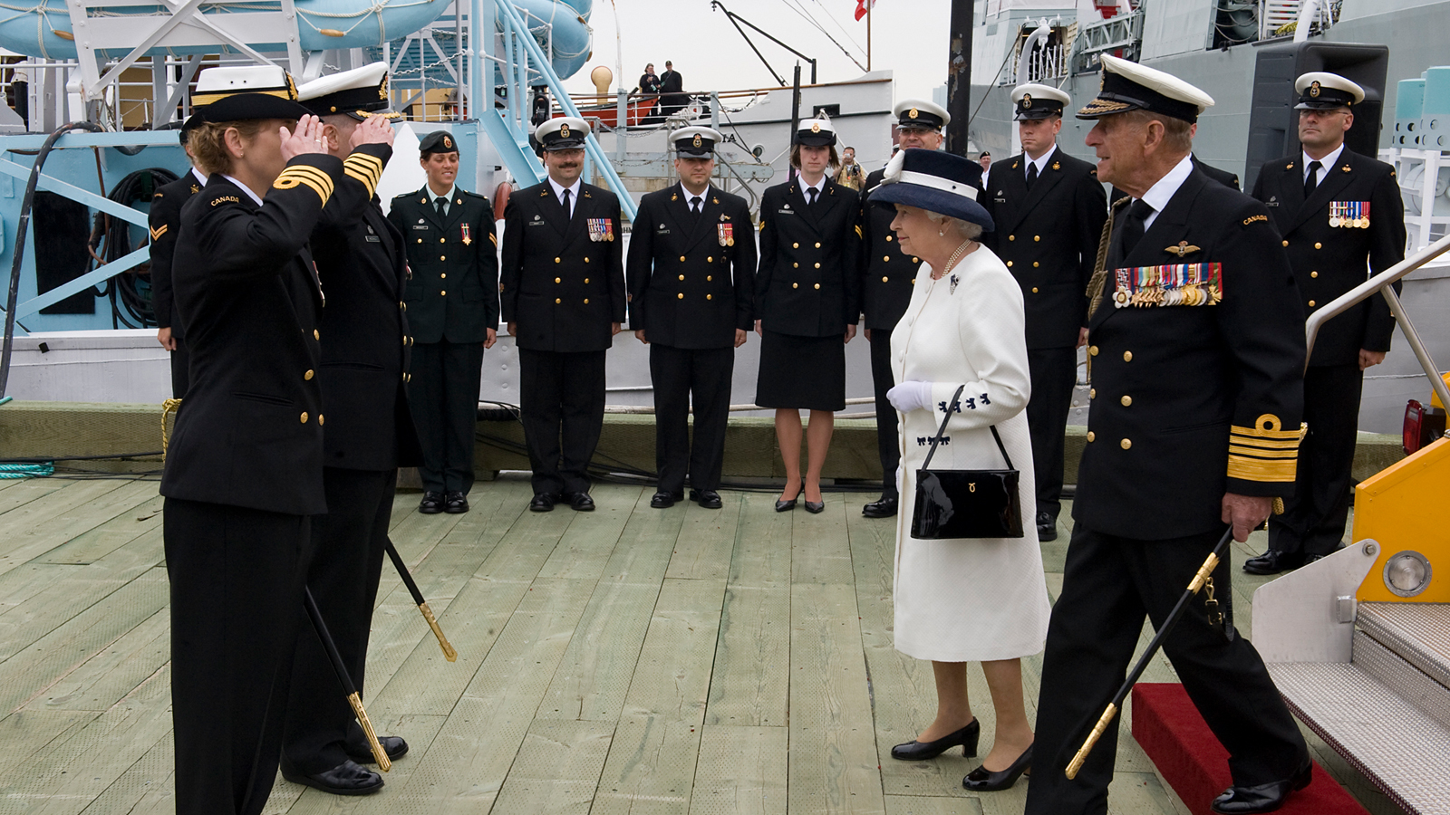 slide - The Queen and Prince Philip during the RCN's centennial celebrations in 2010.